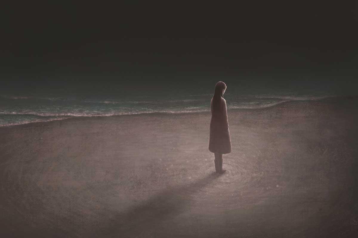 yksinäinen ihminen rannalla